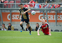 Philadelphia Union midfielder Sebastien Le Toux #9 and Toronto FC defender Richard Eckersley #27 in action during an MLS game between the Philadelphia Union and the Toronto FC at BMO Field in Toronto on May 28, 2011..The Philadelphia Union won 6-2..