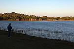 A tourist visiting a lake at sunset, Everglades National Park, Florida, USA