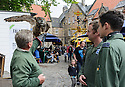 "Edinburgh, UK. 09.08.2016. Cast members, Lewis Howard (as Callum) and  Ben Dyson (as Paddy) from ""Swivelhead"", Pipeline Theatre's new play, meet a barn owl and an eagle owl in the courtyard at the Pleasance. ""Swivelhead"" runs from 3rd - 29th August in Peasance 2. Photograph © Jane Hobson."