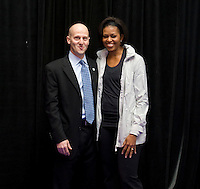 First Lady Michelle Obama stands with US Soccer Foundation COO and general counsel  Rob Kaler during a US Soccer Foundation clinic held at City Center in Washington, DC.