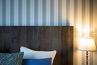Typical Danish minimalist design hotel room with headboard of wooden planks in Denmark