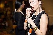 Vanessa Flinn, modeling for Zass Designs, sips from the opened champagne bottle, backstage at Redress Raleigh, 5th Annual Eco-Fashion Show, Saturday, March 23, 2013.