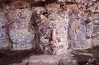 Stucco mask of Kinich-Ahau, the Mayan sun god, at the Temple de Mascarones or Temple of the Masks at Edzna, Campeche, Mexico