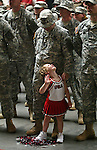 Four-year-old Olivia Roe couldn't wait for the 1034th Combat Sustainment Support Battalion to be dismissed before seeing her father, Captain Dewight Roe, so she joined them while they stood in formation.  The unit had been in Iraq for 14 months, and received a homecoming at Camp Dodge in Des Moines, Iowa.