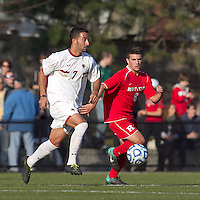 Boston College forward/midfielder Amit Aburmad (7) dribbles as Rutgers University midfielder Nathan Bruccoleri (8) defends. Rutgers University defeated Boston College in penalty kicks after two overtime periods in NCAA Division I tournament action, at Newton Campus Field, November 20, 2011.