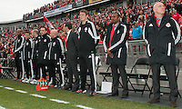 14 April 2012: The coaching and training staff of Toronto FC  stand for the national anthems during the opening ceremonies in a game between Chivas USA and Toronto FC at BMO Field in Toronto..Chivas USA won 1-0..