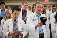 Student Clinician Ceremony. Andrew Nobe, left and Benjamin Brown, both class of 2015, recite The Oath.