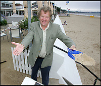 BNPS.co.uk (01202 558833)<br /> Pic: PHT/BNPS<br /> <br /> The hotel's owner John Butterworth.<br /> <br /> Plans to transform the millionaire's resort of Sandbanks into 'Britain's Miami Beach' with two new superhotel's and apartments as part of a &pound;250m development have been unveiled. <br /> <br /> A pair of century-old hotels on the exclusive Dorset peninsula will be bulldozed to make way for an extravagant five star hotel on the beach and a smaller hotel with apartments on the cliffs above.<br /> <br /> The luxurious 175 room establishment will replace the existing Sandbanks Hotel, a former Victorian seaside villa built in the 1880s that is now 'coming to the end of its economic life cycle.'<br /> <br /> In keeping with the Miami Beach look, the super hotel will be Art-Deco in style, have curved floors and painted white with palm trees in the grounds.<br /> <br /> The existing historic Harbour Heights Hotel will also be demolished to make way for the second part of the radical development.