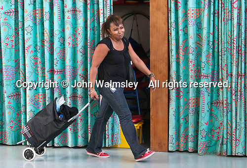 Teacher walking through the hall where a Drama Workshop, is taking place, state Primary school.