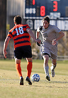 WASHINGTON, DC - NOVEMBER 25, 2012: Andy Riemer (20) of Georgetown University runs up on Ryan Tessler (18) of Syracuse University during an NCAA championship third round match at North Kehoe field, in Georgetown, Washington DC on November 25. Georgetown won 2-1 after overtime and penalty kicks.