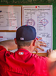 23 May 2015: Washington Nationals Bench Coach Randy Knorr posts the game roster cards on the dugout wall prior to a game against the Philadelphia Phillies at Nationals Park in Washington, DC. The Phillies defeated the Nationals 8-1 in the second game of their 3-game weekend series. Mandatory Credit: Ed Wolfstein Photo *** RAW (NEF) Image File Available ***