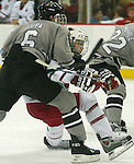 10/22/04 Omaha, Neb Western Michigan's JOnathan Lupa tries to hold back University of  Nebraska at Omaha's  Bill Thomas at the Qwest Center Omaha Friday night.(chris machian/Prarie Pixel Group)