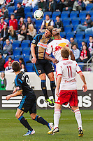 Jeff Parke (31) of the Philadelphia Union goes up for a header with Jamison Olave (4) of the New York Red Bulls. The New York Red Bulls defeated the Philadelphia Union 2-1 during a Major League Soccer (MLS) match at Red Bull Arena in Harrison, NJ, on March 30, 2013.
