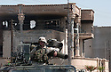 U.S. Army 101st Airborne troops guards a destroyed residence on July 23, 2003 where Saddam Hussein's sons Uday and Qusay were killed in Mosul, Iraq the day before. The two sons of the former Iraqi leader Saddam Hussein were cornered in an affluent home in the northern city of Mosul and killed in what U.S. military officials described as a fierce firefight that lasted for several hours.