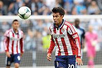 Carlos Alvarez (20) midfield Chivas USA heads the ball..Sporting Kansas City defeated Chivas USA 4-0 at Sporting Park, Kansas City, Kansas.