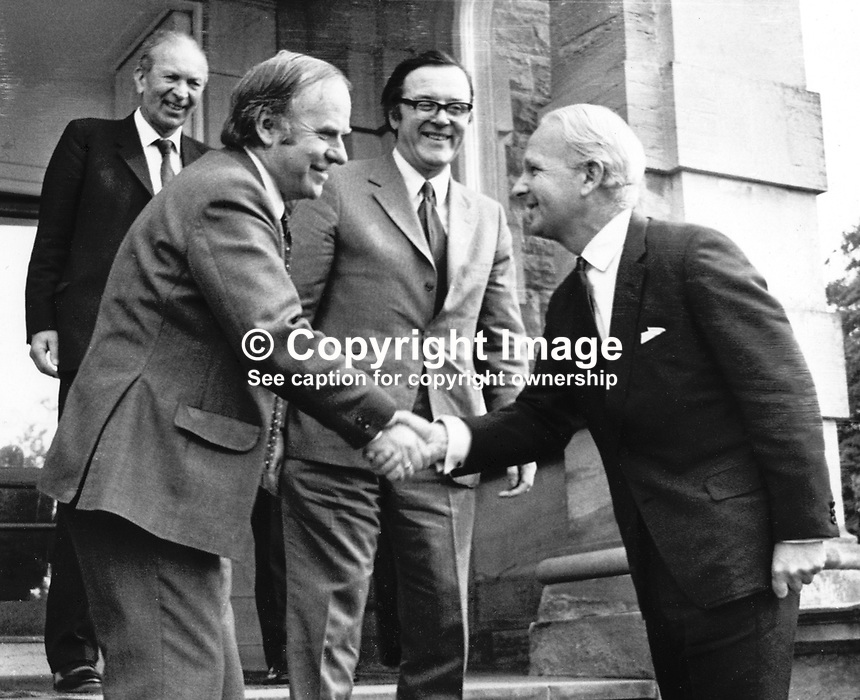 Brian Faulkner, chief minister, N Ireland Executive (right), meets the newly-appointed Minister of State for N Ireland, Stan Orme. Also in the photo is the Secretary of State for N Ireland, Merlyn Rees. Taken; 6th March 1974. They are pictured on the steps of Stormont Castle. 197403060022b.<br /> <br /> Copyright Image from Victor Patterson, 54 Dorchester Park, <br /> Belfast, UK, BT9 6RJ<br /> <br /> t1: +44 28 9066 1296 (from Rep of Ireland 048 9066 1296)<br /> t2: +44 28 9002 2446 (from Rep of Ireland 048 9002 2446)<br /> m: +44 7802 353836<br /> <br /> e1: victorpatterson@me.com<br /> e2: victorpatterson@gmail.com<br /> www.victorpatterson.com<br /> <br /> Please see my Terms and Conditions of Use at www.victorpatterson.com. It is IMPORTANT that you familiarise yourself with them.<br /> <br /> Images used on the Internet must be visibly watermarked i.e. &copy; Victor Patterson<br /> within the body of the image and copyright metadata must not be deleted. Images <br /> used on the Internet have a size restriction of 4kbs and will be chargeable at current<br />  NUJ rates unless agreed otherwise.<br /> <br /> This image is only available for the use of the download recipient i.e. television station, newspaper, magazine, book publisher, etc, and must not be passed on to any third <br /> party. It is also downloaded on condition that each and every usage is notified within 7 days to victorpatterson@me.com<br /> <br /> The right of Victor Patterson to be identified as the author is asserted in accordance with The Copyright Designs And Patents Act (1988). All moral rights are asserted.