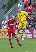 July 20, 2013: Columbus Crew defender Chad Marshall #14 and Toronto FC forward Jeremy Brockie #22 in action during a game between Toronto FC and the Columbus Crew at BMO Field in Toronto, Ontario Canada.<br /> Toronto FC won 2-1.
