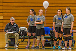 1 November 2015: Yeshiva University Maccabee Head Coach Joseph Agrest prepares his lineup as Outside Hitter, Setter, and team co-Captain Shana Wolfstein, a Senior from Burlington, VT, smiles with teammates Yael Ghelman, Aliza Muller, and Marissa Almoslino prior to a match against the SUNY College at Old Westbury Panthers at SUNY Old Westbury in Old Westbury, NY. The Panthers edged out the Maccabees 3-2 in NCAA women's volleyball, Skyline Conference play. Mandatory Credit: Ed Wolfstein Photo *** RAW (NEF) Image File Available ***