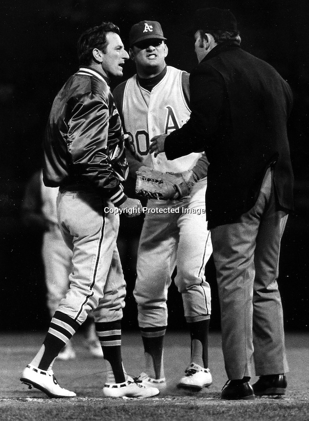 A's manager John McNamara with Don Mincher and umpire.(1970 photo by Ron Riesterer)