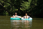 Paddling a kayak among tubers in Green River Cove on Labor Day weekend.