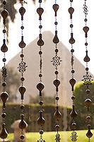An Eyptian Pyramid seen through hanging beads, Giza, Egypt