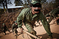 "KIA civilian militia during guerrilla training at one of the trainig camps outskirsts Laiza city, the headquarters of the Kachin Independence rebel Army. The civilian militia is called ""People's Army"", a secret army under the command of the KIA. The KIA is enhancing its troops number since the ceasefire was broken out by the Burmese army last June 2011. During months the fighting were spread out along the Kachin State leaving more than 40,000 displaced persons and refugees (a conservative estimating) in accord with the humanitarian aid groups."
