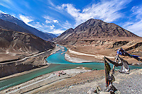 The confluence of the Zanskar River (from top) and the Indus (bottom flowing from left to right).  Ladakh,  Jammu and Kashmir, India.