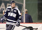 Nick Sorkin (UNH - 21) - The University of Maine Black Bears defeated the University of New Hampshire Wildcats 5-4 in overtime on Saturday, January 7, 2012, at Fenway Park in Boston, Massachusetts.
