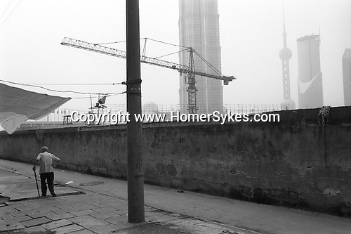 The Peoples Republic of China. Shanghai. 2000. A quiet corner in Pudong.  Twenty years ago Pudong was agricultural land growing vegetables and cotton, with only the river frontage built up.  The former warehouses of the international companies that left in the 1940s fronted the river, mostly decayed or converted to light industrial use, while the shipyards had moved further down river.  .