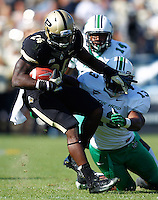 WEST LAFAYETTE, IN - SEPTEMBER 29: Akeem Shavers #24 of the Purdue Boilermakers runs the ball as Armonze Daniel #13 of the Marshall Thundering Herd attempts to tackle at Ross-Ade Stadium on September 29, 2012 in West Lafayette, Indiana. (Photo by Michael Hickey/Getty Images) *** Local Caption *** Akeem Shavers; Armonze Daniel
