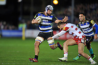 Leroy Houston of Bath Rugby looks to fend Bill Meakes of Gloucester Rugby. Aviva Premiership match, between Bath Rugby and Gloucester Rugby on February 5, 2016 at the Recreation Ground in Bath, England. Photo by: Patrick Khachfe / Onside Images