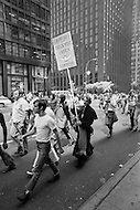 28 Jun 1970; Manhattan; New York City; New York State; USA.First Gay Parade was held in New York City. The begining of the parade men gave flowers to each others.
