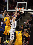 Northern Iowa's Seth Tuttle (10) dunks the ball against Wyoming's Josh Adams (14) in the  2015 NCAA Division I Men's Basketball Championship March 20, 2015 at the Key Arena in Seattle, Washington.   Northern Iowa beat Wyoming 71 to 54.   ©2015.  Jim Bryant Photo. All Rights Reserved.