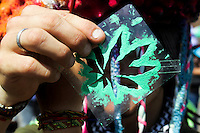 A man shows a marijuana leaf acetate during a demonstration in support for legalization of marijuana in Bogota, May 4, 2013. Photo by Freddy Builes / VIEWpress.
