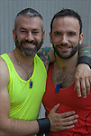 Half length portrait of gay couple at Folsom Street East S&M street fair in New York City