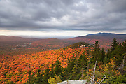 Scenic view from Middle Sugarloaf Mountain in Bethlehem, New Hampshire USA during the autumn months. North Sugarloaf Mountain is right / center.