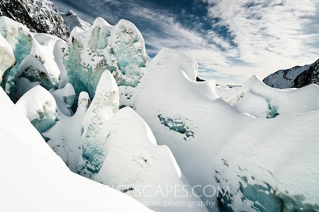 Beautiful shapes of deep, freshly snowed up crevasses on Franz Josef Glacier, Westland National Park, West Coast, New Zealand