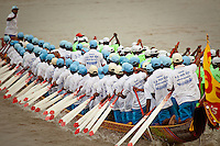 Dragon boat racing teams compete at the annual Water Festival, aka Bon Om Touk, in Phnom Penh, Cambodia. The festival takes place during the full moon in November at the confluence of the Mekong &amp; Tonle Sap rives