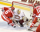 Joe Pereira (BU - 6) puts the loose puck in the back of the net behind John Muse (BC - 1) to make it 3-2 BC 5:26 into the second period. - The Boston College Eagles defeated the visiting Boston University Terriers 5-2 on Saturday, December 4, 2010, at Conte Forum in Chestnut Hill, Massachusetts.