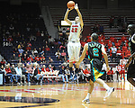 Mississippi's Marshall Henderson (22) makes a three pointer against Coastal Carolina's Anthony Raffa (2) at the C.M. &quot;Tad&quot; Smith Coliseum in Oxford, Miss. on Tuesday, November 13, 2012. Henderson led all scorers with 27 points in Mississippi's 90-72 win. (AP Photo/Oxford Eagle, Bruce Newman)