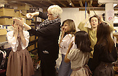 "Hair dresser working on the actors.  Drama group for 8-13s rehearsing a production of ""Alice"" in the Mill Studio at the Yvonne Arnaud Theatre, Guildford, Surrey."
