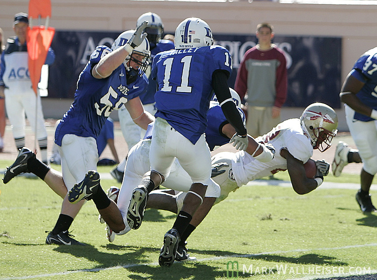 Seminole runningback Lorenzo Booker (R) is followed by a group of Duke defenders as he leaps into the endzone in the third quarter of their 51-24 victory over the Blue Devils at Wallace Wade Stadium in Durham, North Carolina October 14, 2006.