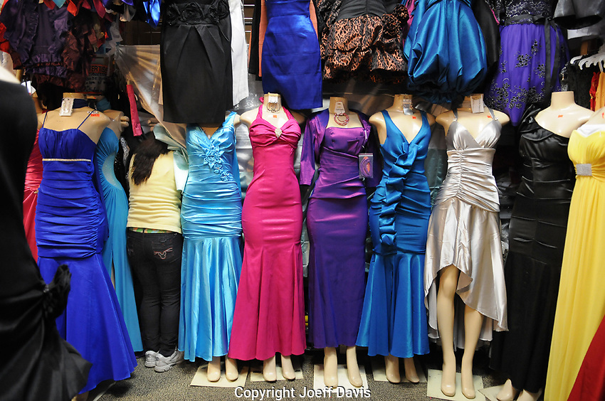 This photo was shot at Alexis Fashion at Plaza Fiesta on Buford Highway. I was doing a photo shoot at Plaza Fiesta for CL's Neighborhood Guide when a man approached me and asked if I would take some photos in his store. As I entered his store I saw this scene and immediately started rapidly shooting pictures without exchanging another word with him, much to his surprise. I like this image because of the woman worker on the left side of the frame buried amongst the mannequins.