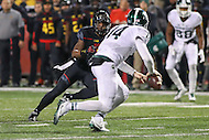 College Park, MD - October 22, 2016: Maryland Terrapins defensive back JC Jackson (7) puts presser on Michigan State Spartans quarterback Brian Lewerke (14) during game between Michigan St. and Maryland at  Capital One Field at Maryland Stadium in College Park, MD.  (Photo by Elliott Brown/Media Images International)