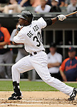 CHICAGO - JULY 27:  Alejandro De Aza #30 of the Chicago White Sox hits a two-run home run in the second inning against the Detroit Tigers on July 27, 2011 at U.S. Cellular Field in Chicago, Illinois.  The White Sox defeated the Tigers 2-1.  (Photo by Ron Vesely)  Subject: Alejandro De Aza