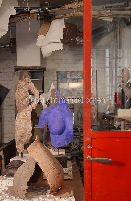 Clay moulds for figurative sculptures in the Soleil Rouge workshop of Nicolas Desbons, metalworker and artist, photographed in 2017, in Montreuil, a suburb of Paris, France. Desbons works mainly in steel but often in conjunction with other materials such as fibreglass, glass and clay, using both cold metal and forge techniques. He produces both figurative and abstract sculptures as well as furniture and lighting. Picture by Manuel Cohen
