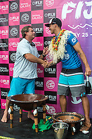 Namotu Island Resort, Namotu, Fiji. (Thursday June 5, 2014) Scotty O'Connor (AUS) co-owner of Namotu Island where Medina was staying recieves the perpetual trophy awarded between the rival islands of Tavarua and Namotu where all the surfers stay.&ndash; The 2014 Fiji Pro was won by Gabriel Medina (BRA) this morning after defeating USA's Nat Young (USA) in the 40 minute final. Medina had defeated Kolohe Andino (USA) in the first semi final and Young had defeated Michel Bourez (PYF) in their semi final.<br /> Medina moved to  the top of the WCT ratings with his win. Photo: joliphotos.com
