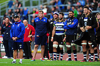 Bath Rugby first team coach Darren Edwards, Stuart Hooper, Henry Thomas, Guy Mercer, Taulupe Faletau and Charlie Ewels look on from the sidelines. Pre-season friendly match, between the Scarlets and Bath Rugby on August 20, 2016 at Eirias Park in Colwyn Bay, Wales. Photo by: Patrick Khachfe / Onside Images