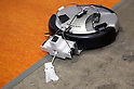 May 131, 2012, Tokyo, Japan - A small robot cleans the floor. The Smart Grid Exhibition and Automotive Next Industry Fair 2012 shows the next generation of vehicles and manufacturing working with eco energy, from May 30th. to June 1st. at Tokyo Big Site.
