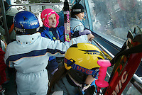 Switzerland. State of Ticino. Airolo. Tourists and skiers use a cable car to access the Peschün ski resort. © 2005 Didier Ruef